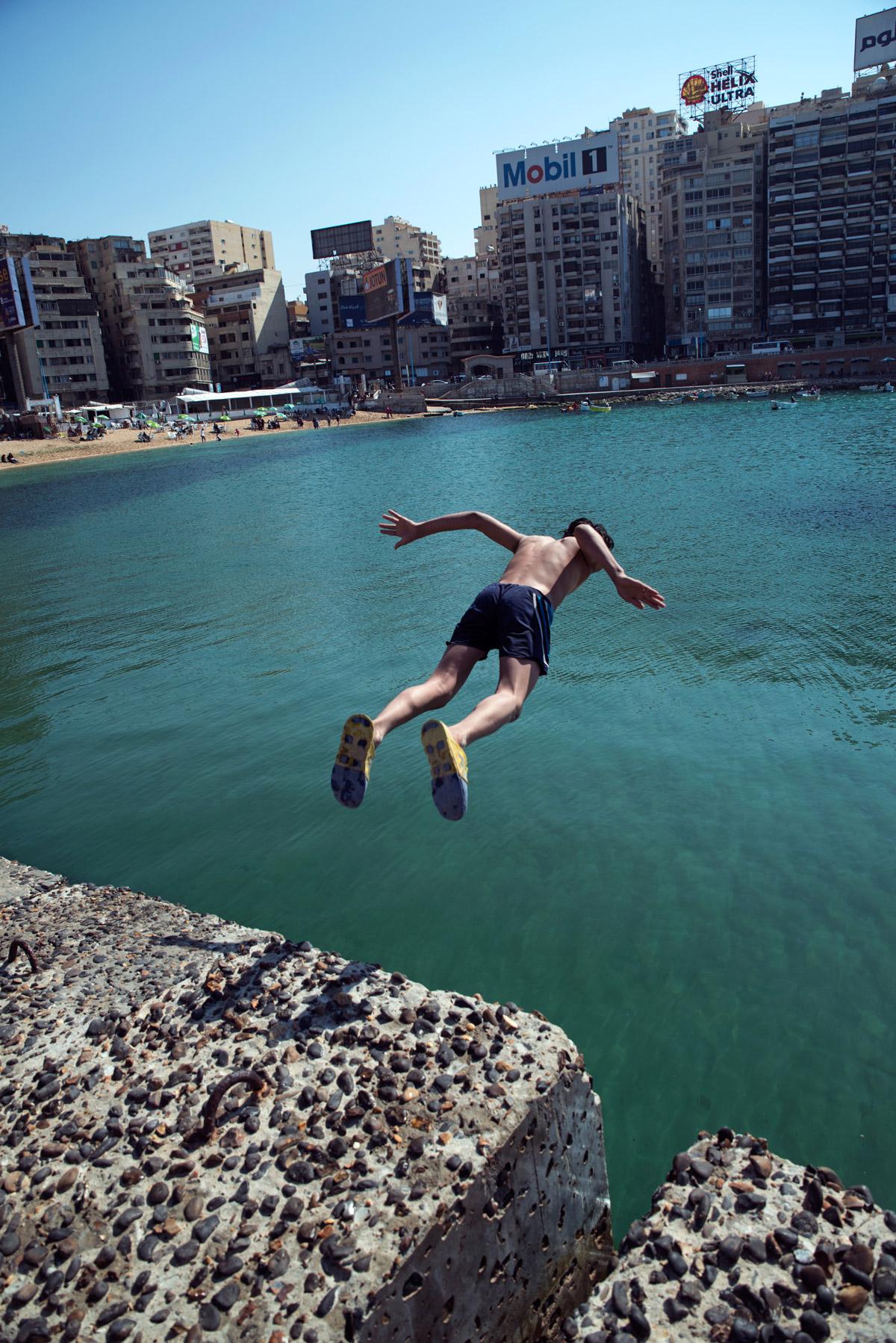 A boy jumps into the sea at Gleem Beach.