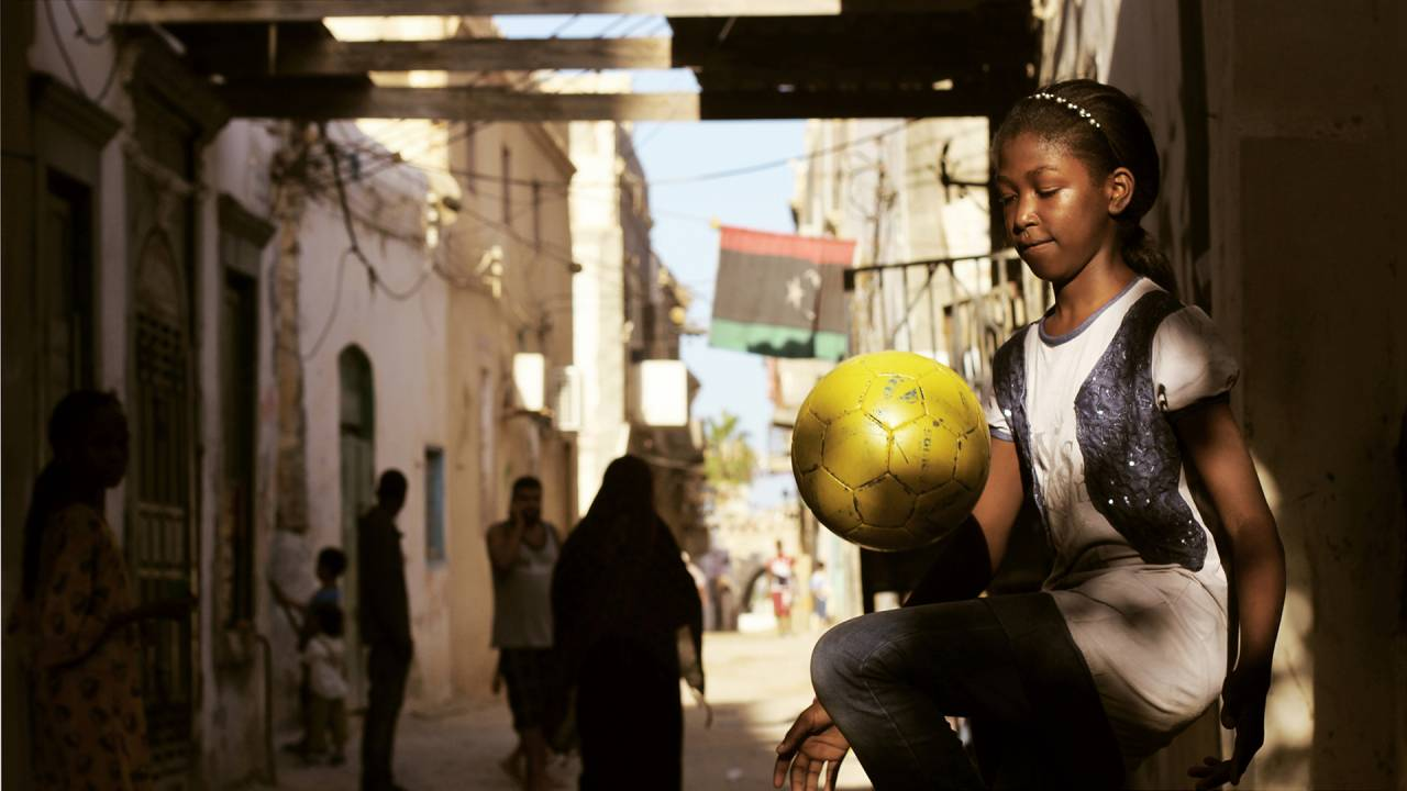 Little Girl playing Football.jpg
