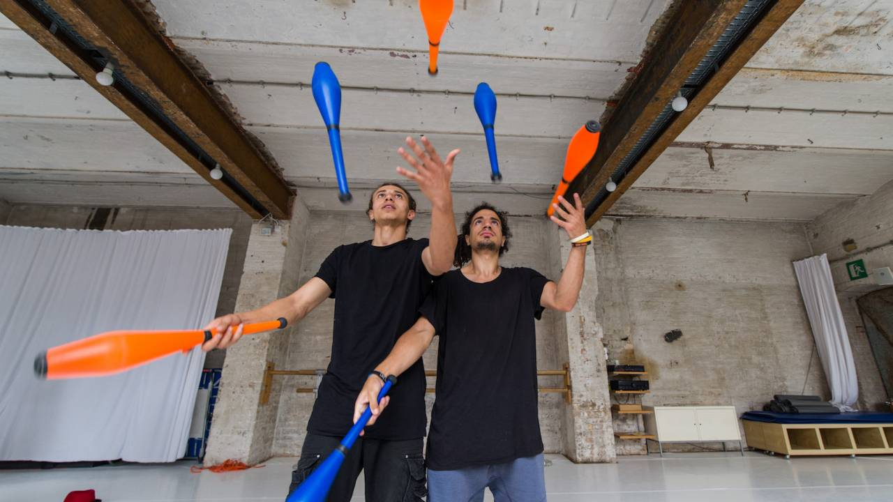 Mohamed and Khaled showing off their juggling skills