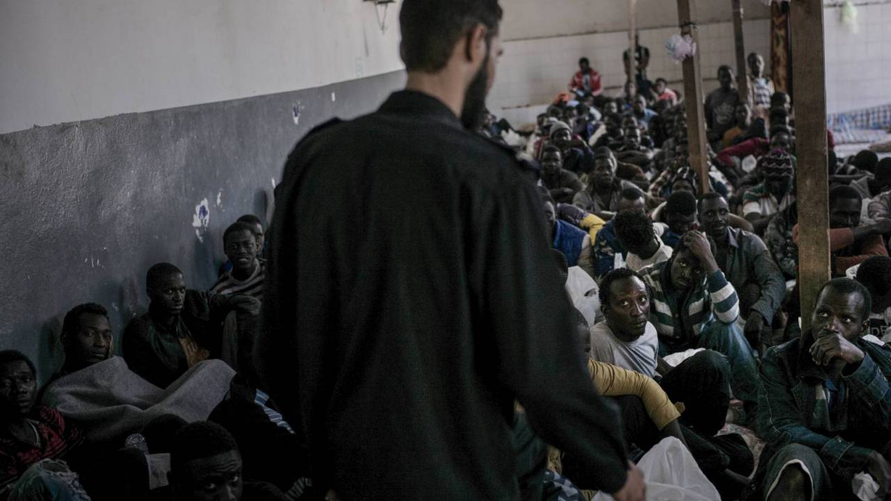 A group of migrants inin a detention centre in Libya.