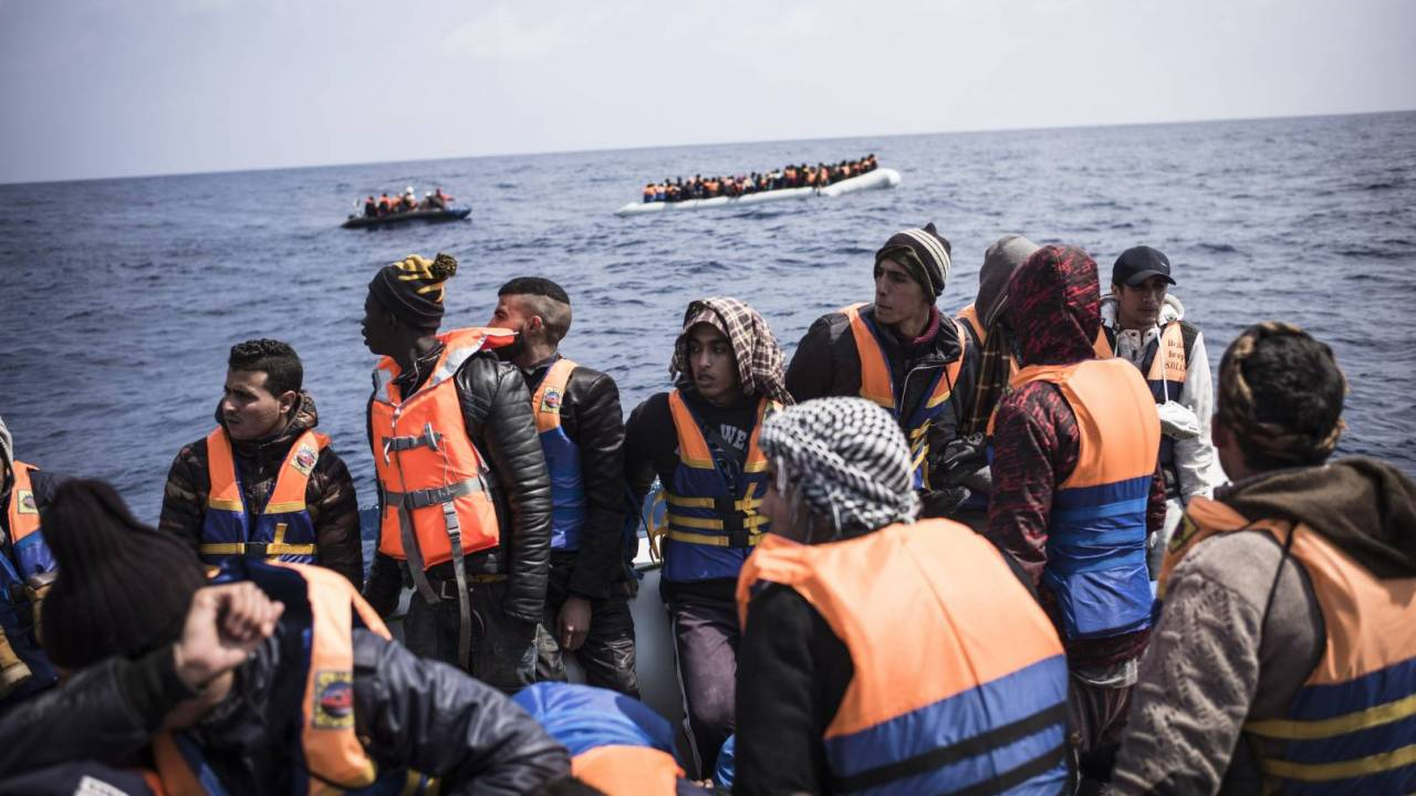 A boat carrying refugees in the middle of the sea