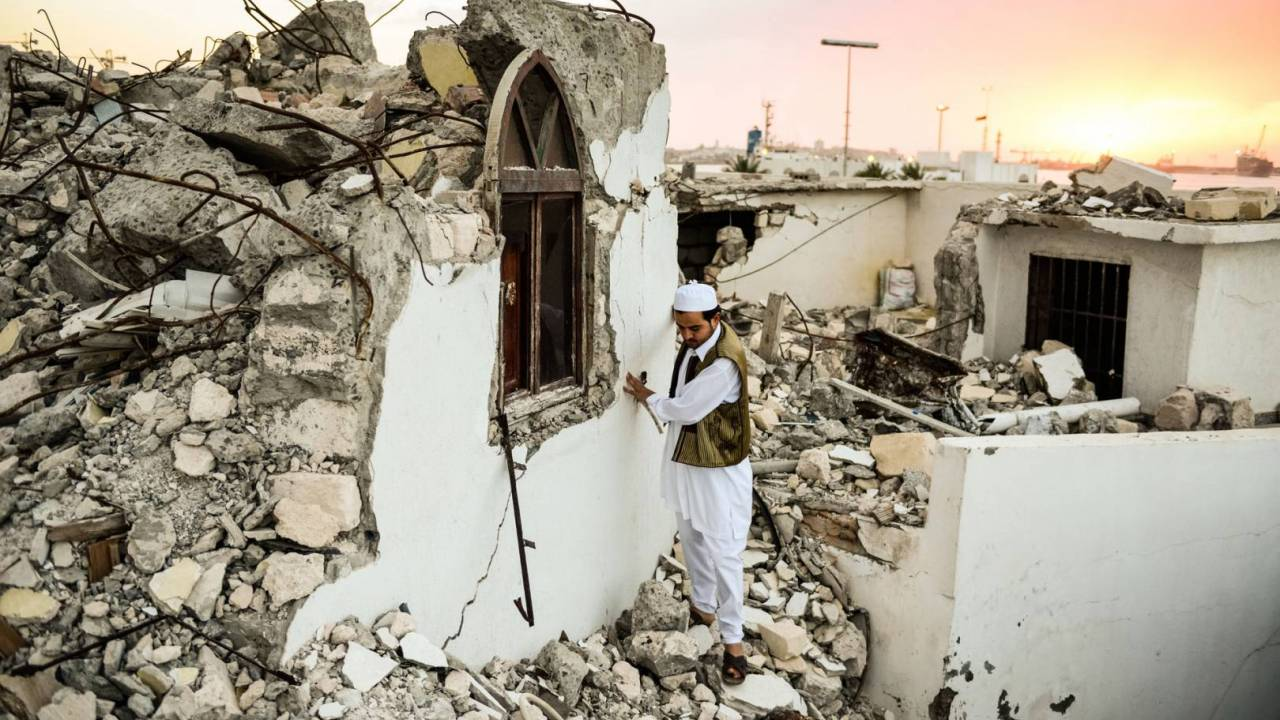 Abubaker surveying the ruins of Sidi Shaab mosque after it was destroyed in an attack by Salafi militants.