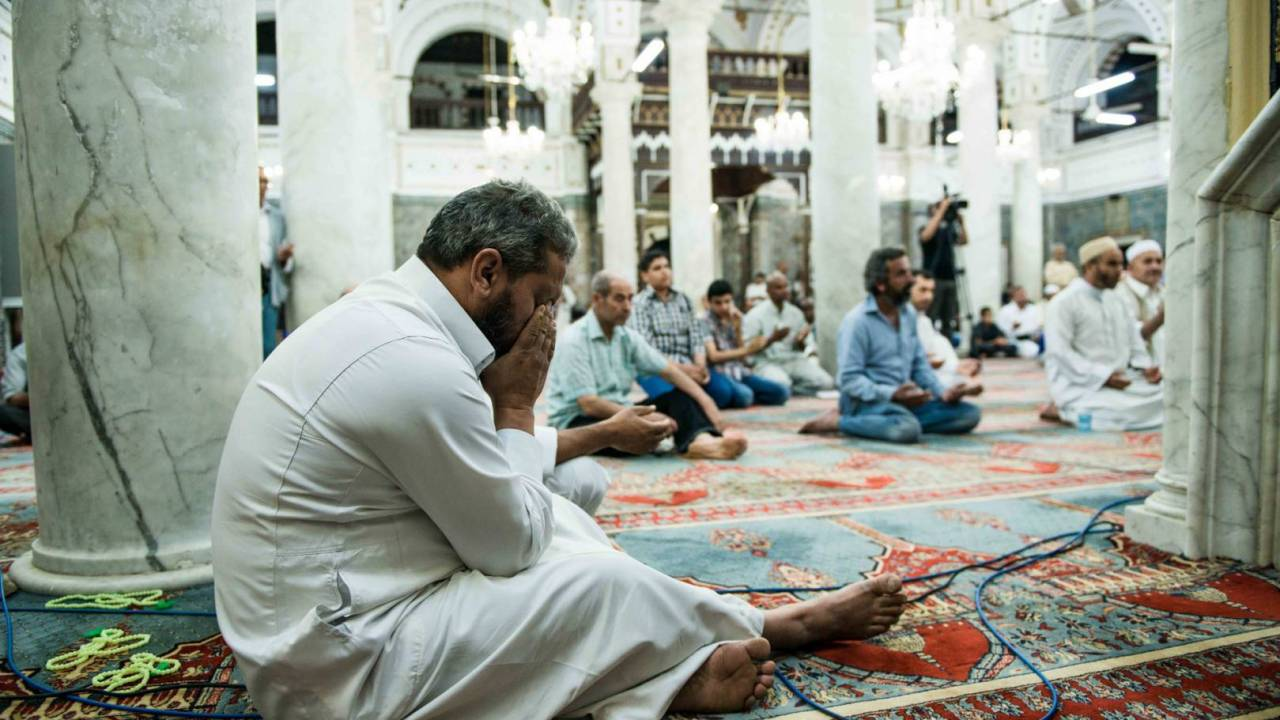 A man crying during an emotional Dua (prayer) by the Imam on the targeting of Sufis and their places of worship in Tripoli and around the city.