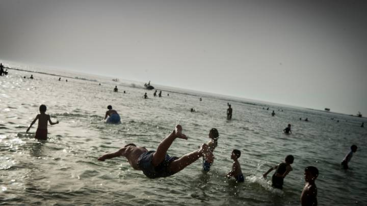 Libyans Enjoy Summer Swimming.