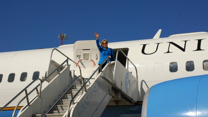 Hillary Clinton boards a plane to Uruguay