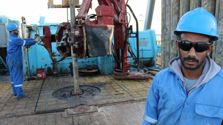 File photo: An oil worker in the south of Libya photographed in 2014.