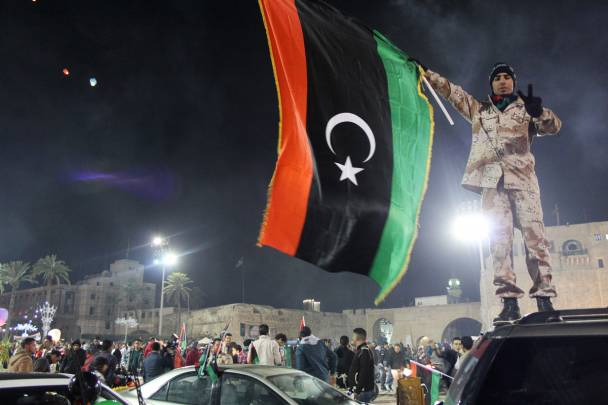 A militia man with a Libyan flag in downtown Tripoli.