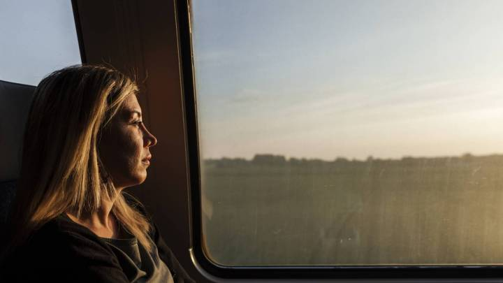 Lilas Hatahet, a Syrian refugee, journalist and separated mother of two boys, sits on the train on her way back home after finishing her work day in Copenhagen where she's working as a Media Advisor.