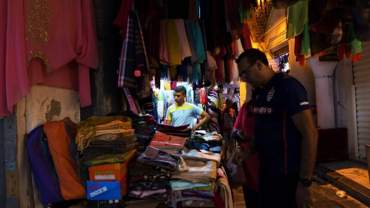 A man examines wares in the souk in Tunis' old city.
