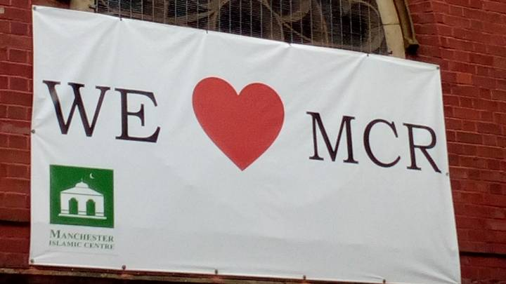 A 'We love Manchester' sign hanging on the Didsbury Mosque, where the Manchester Arena bomber Salman Abedi had worshipped.