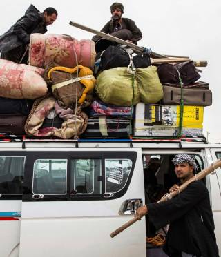 العمال العائدون من ليبيا
