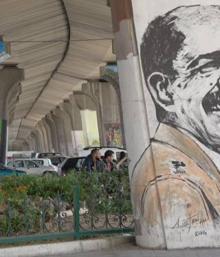 A mural of Chokri Belaid, a politician assassinated in 2013.